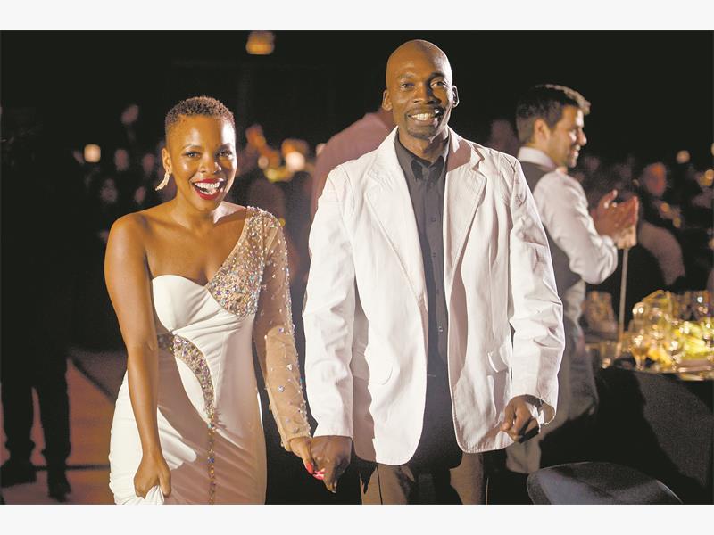 TEAMWORK. Power FM presenter Masechaba Lekalake, left, celebrates with executive producer Bongani Mahlangu after they won the Best Night-Time Show Award for 'Power Life' at the MTN Radio Awards. Pictures: Michel Bega.