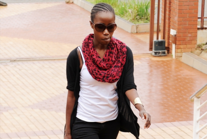 Generations actress Maggie Benedict leaves the Randburg Magistrate's Court on February 6, 2014 in Johannesburg, South Africa. Benedict was arrested for allegedly stealing a small pocket of Panados in December. The case has been postponed to next week. (Photo by Gallo Images / Daily Sun / Jan Right).