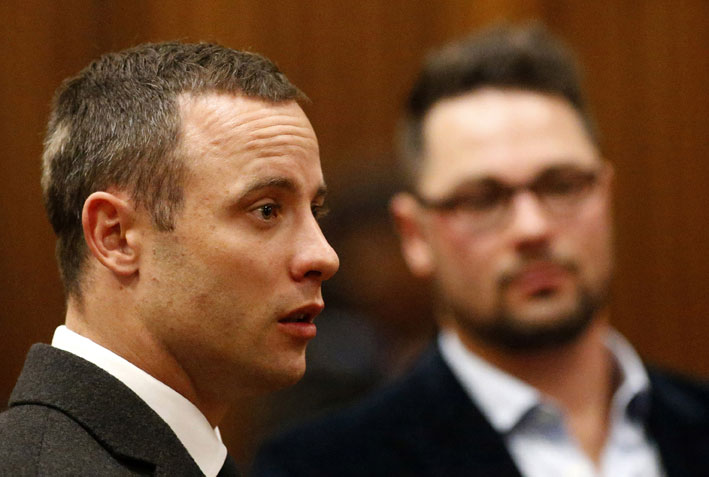 FILE PICTURE: Paralympian and murder-accused Oscar Pistorius is seen with his brother Carl (background) at the high court in Pretoria on Tuesday, 20 May 2014. Pistorius would be admitted as a day-patient at Weskoppies Psychiatric Hospital for mental observation, the court ordered on Tuesday. Picture: Siphiwe Sibeko/Reuters/Pool