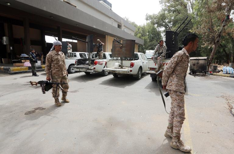 Former rebel fighters now intergrated into the Libyan army and guard the western entrance of the capital Tripoli on May 19, 2014