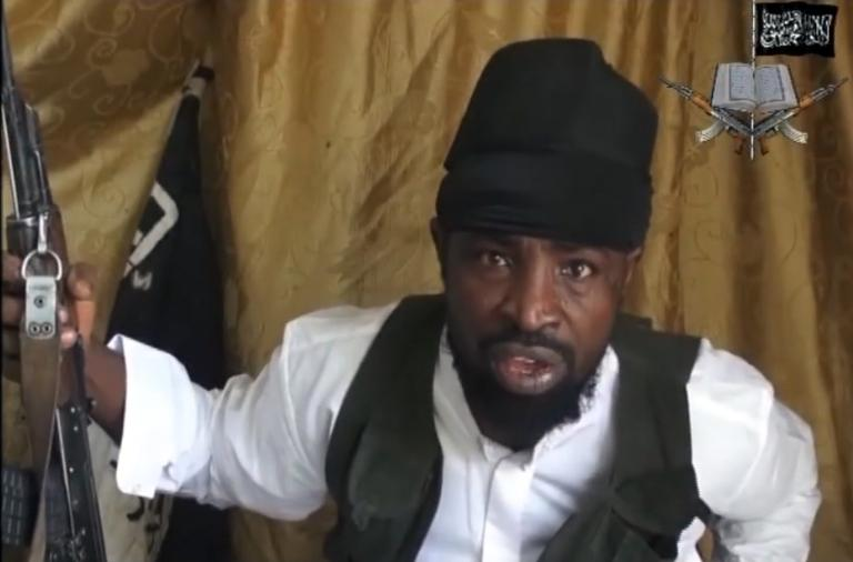 FILE PICTURE: A screengrab taken on March 24, 2014 from a video obtained by AFP shows a man claiming to be the leader of Nigerian Islamist extremist group Boko Haram, Abubakar Shekau