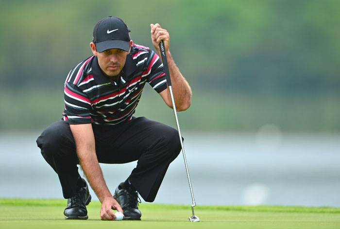 FILE PICTURE: Charl Schwartzel of South Africa lines up a putt during the continuation of the weather delayed first round of the Nedbank Golf Challenge at Gary Player CC on December 6, 2013 in Sun City, South Africa.  (Photo by Stuart Franklin/Getty Images)