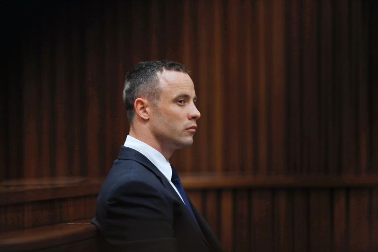 FILE PICTURE: South African Paralympic sprinter Oscar Pistorius sits in the dock during the testimony of a defence witness at his murder trial at the high court in Pretoria on May 6, 2014. Picture: AFP.