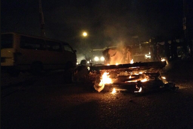 Tyres and vehicles burn in Alexandra, north of Johannesburg as violence erupts on 9 May 2014. Image twitter @amandzing1