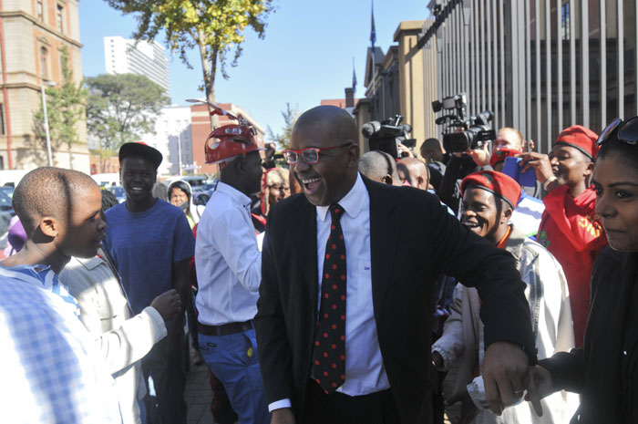 Advocate Dali Mpofu of the Economic Freedom Fighters exits the North Gauteng High Court in Pretoria, 26 May 2014, after the court ruled that EFF leader Julius Malema's provisional sequestration of his estate has been extended to August 25. Picture: Alaister Russell