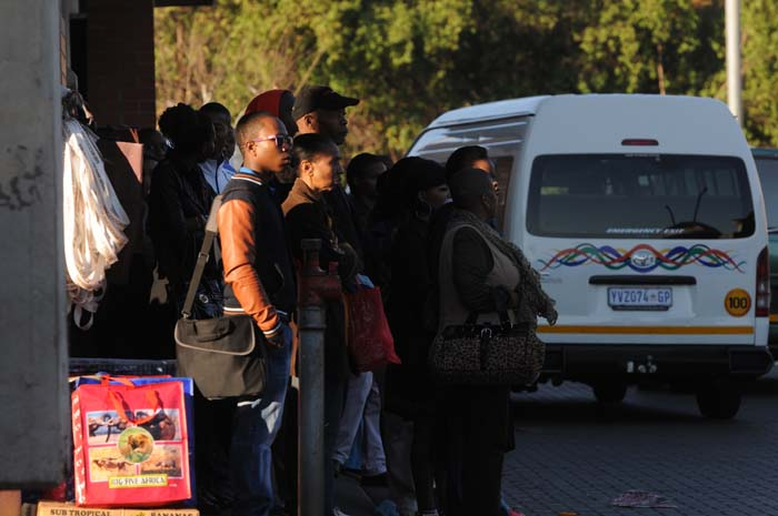 Commuters wait patiently for the taxi to arrive at Bara taxi rank in Johannesburg. Picture: Nigel Sibanda