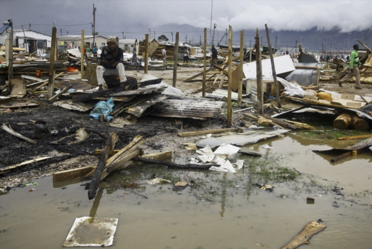 FILE PICTURE: Demolished shacks on June 3, 2014 in Cape Town, South Africa. Hundreds of Nomzamo Informal Settlement residents were left out in the cold after authorities evicted them from the area, saying they are illegally occupying privately owned land. The land belongs to Sanral and is designated for the rerouting of the N2. Picture: Gallo Images / The Times / Thomas Holder.