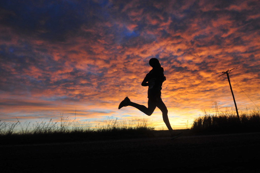 FILE PICTURE: The sun rises over runners competing in the 89th Comrades Marathon, 01 June 2014, from Pietermaritzburg to Durban. The annual ultra-marathon attracted over 18,000 runners from around the world to partake in the 89km race. Picture: Alaister Russell