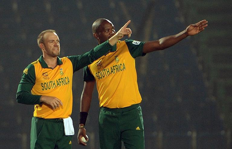 South Africa players AB de Villiers (L) and Lonwabo Tsotsobe gesture during ICC World Twenty20 cricket tournament warm-up match between South Africa, Bangladesh A at Khan Shaheb Osman Ali Stadium in Fatullah on outskirts of Dhaka on March 18, 2014
