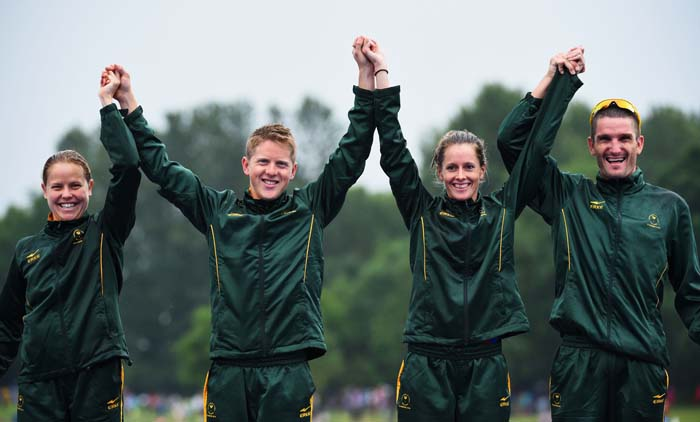 FILE PICTURE: (L-R) Silver medalists Kate Roberts, Henri Schoeman, Gillian Sanders and Richard Murray of South Africa celebrate on the podium during the medal ceremony for the Triathlon Mixed Team's Relay Final at Strathclyde Country Park during day three of the Glasgow 2014 Commonwealth Games on July 26, 2014 in Glasgow, United Kingdom.  (Photo by Jeff J Mitchell/Getty Images)