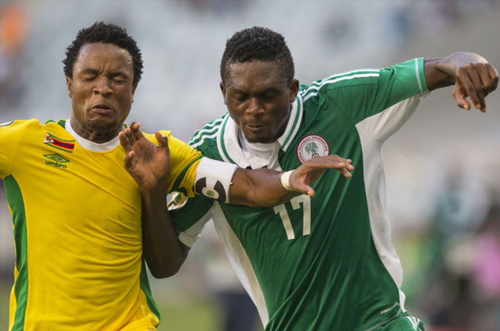 Partson Jaure (C) (left) and Chinonso Christian Obiozor (right) during the 2014 African Nations Championship 3rd and 4th play off between Nigeria and Zimbabwe at Cape Town Stadium on February 01, 2014 in Cape Town, South Africa. (Photo by Manus van Dyk/Gallo Images)