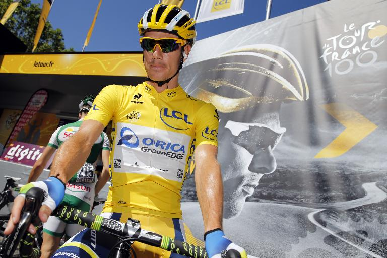 FILE PICTURE: Daryl Impey wears the overall leader's yellow jersey before the start of the eightht stage of the Tour de France on July 6, 2013. Picture: AFP