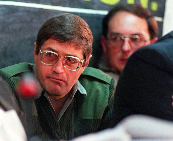 FILE PICTURE:  Eugene De Kock, who was sentenced to 289 years imprisonment and life sentence for 87 crimes, being guarded by a prison warder at the Truth and Reconciliation Commission (TRC) hearing. Apartheid-era assassin Eugene de Kock, a police colonel known as 'Prime Evil', was refused parole on July 10, 2014 after serving 20 years in prison. AFP PHOTO / WALTER DHLADHLA