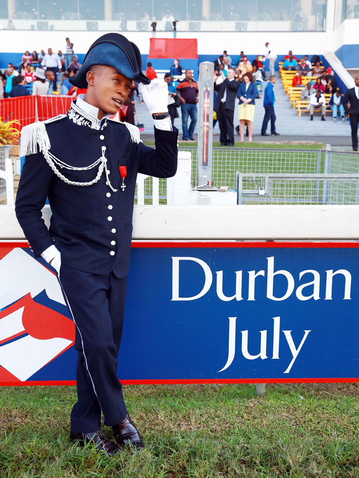 FILE PICTURE: A model arrives dressed up for a fashion competition during the annual Durban July horse race on July 5, 2014, in Durban, South Africa. The Durban July horse race is the biggest horse racing event on the African continent and a high social event where South African celebrities dress up and watch the race. It attracts close to 100,000 spectators and bets are placed in excess of 20 million US dollars. AFP PHOTO / RAJESH JANTILAL