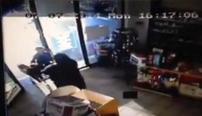 A woman is seen pushing the trolley with two four-year-old twins out of a pharmacy in Pretoria.