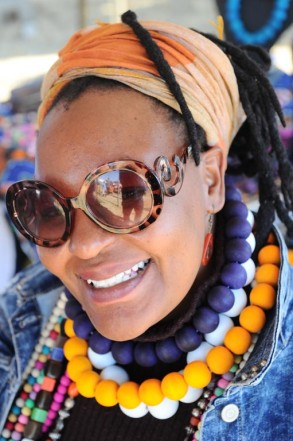 Sibongile Mkhwanazi, owner of Eyezulu Jewels, shows off some of her jewellery, 6 July 2014, at the Locrate Market in Orlando West, Soweto. Mkhwanazi, from Soweto, makes the jewellery at her home and has a stall at the market every month. Picture: Michel Bega