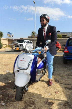 Katlego Ramela arrives on a scooter, 6 July 2014, at the Locrate Market in Orlando West, Soweto. Picture: Michel Bega