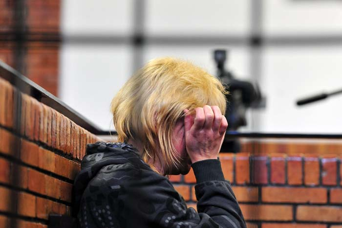 The wife  of the man accused of abusing her and their five children and holding them captive appears in the Springs Magistrate's Court in Ekurhuleni, Tuesday 2 July 2014. Picture: Neil McCartney