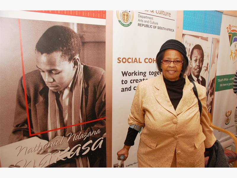 Gladys Maphumulo sister to Nat Nakasa walks past to some of his photographs after the media briefing wich was held in Durban. Picture Phumlani Thabethe Date 02 July 2014