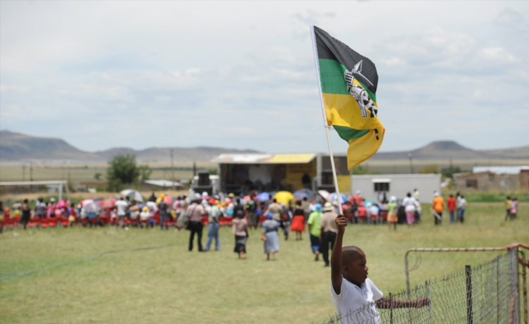FILE PICTURE: Young ANC supporter Omolimo Vinger (12) awaits the arrival of ANC leaders. Picture: Gallo Images / Foto24 / Felix