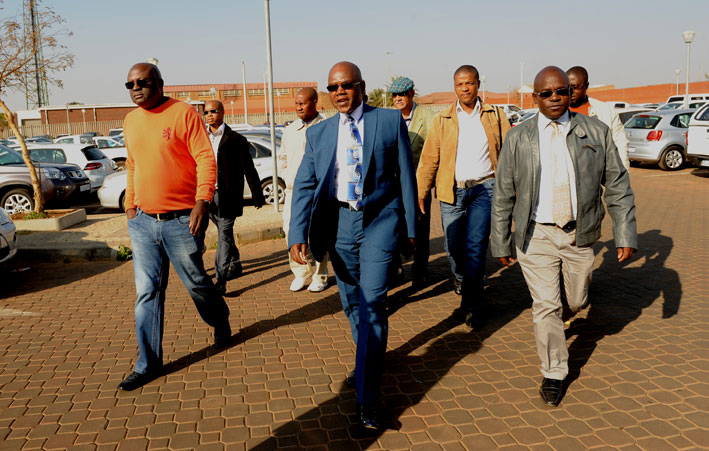FILE PICTURE: Former police crime intelligence boss Richard Mdluli (C) arrives at the Palm Ridge Magistrate's Court with an entourage of men on Monday, 11 August 2014. Mdluli was formally charged in the High Court in Johannesburg, sitting in Palm Ridge, on Monday. He faces charges including kidnapping, assault with intent to do grievous bodily harm, intimidation, and defeating the ends of justice related to a 15-year-old crime. Picture: Werner Beukes/SAPA