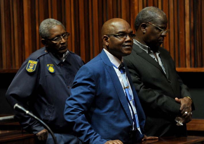 FILE PICTURE: Former police crime intelligence boss Richard Mdluli (L) and co-accused Mthunzi-Omhle Mtunzi appear at the Palm. Picture: Werner Beukes/SAPA