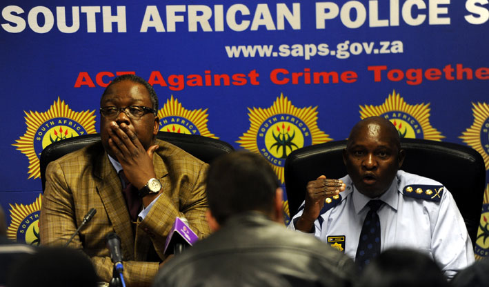 Police Minister Nathi Nhleko (L) and Gauteng police commissioner Lt-General Lesetja Joel Mothiba answer questions from the media at a news conference at the provincial head office of the SAPS in Parktown, Johannesburg, Tuesday, 19 August 2014. Picture: Werner Beukes/SAPA