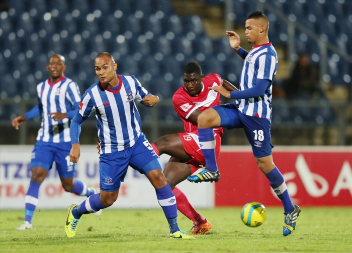 FILE PICTURE: Robyn Johannes and Ryan de Jongh of Maritburg United combine to block a shot from Basit Adam during the Absa Premiership match between Maritzburg United and Free State Stars at Harry Gwala Stadium on March 11, 2014 in Pietermaritzburg, South Africa. (Photo by Anesh Debiky/Gallo Images)