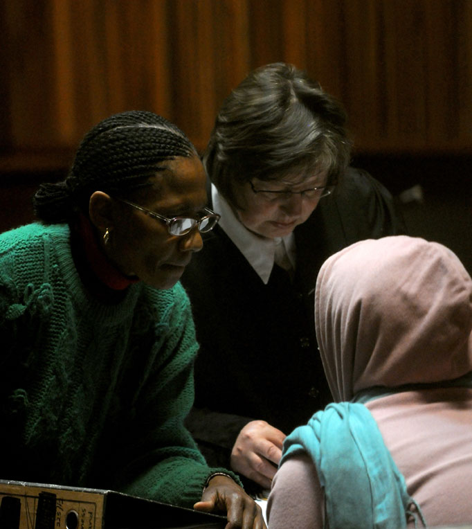 FILE PICTURE: Loretta Cooke with mother (L) and her lawyer at Palm Ridge magistrate court in Johannesburg, 25 August 2014, during her appearance for slicing a woman's womb open during a brutal attempt to steal the unborn child. Picture: Nigel Sibanda