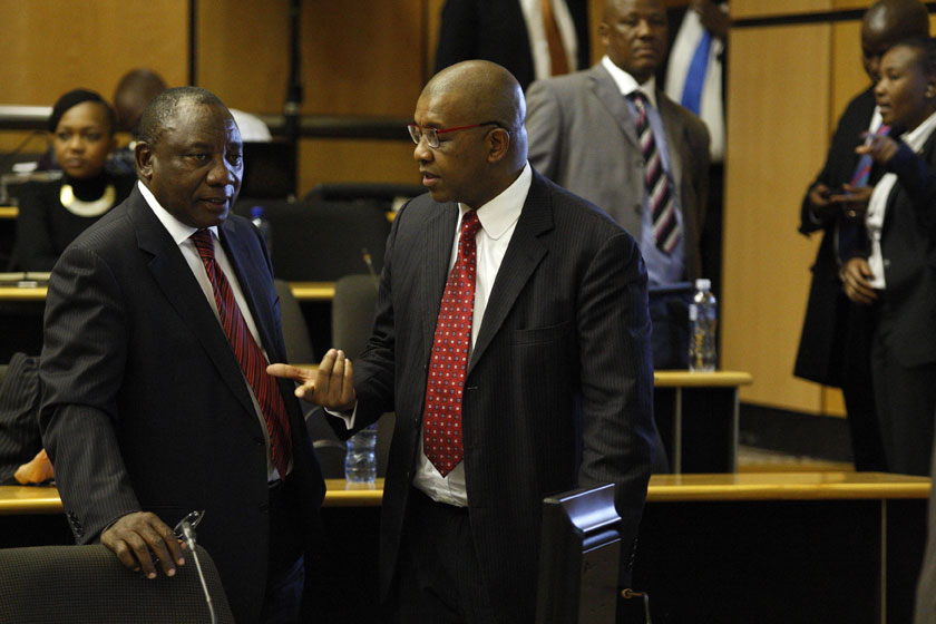 PRETORIA, SOUTH AFRICA - AUGUST 12: Deputy President Cyril Ramaphosa and Advocate Dali Mpofu at the Marikana Commission of Inquiry on August 12, 2014 in Pretoria, South Africa. Ramaphosa defended his role during the August 2012 mining unrest. He said he did not tell former police minister Nathi Mthethwa how to intervene in the strike. The commission is investigating what led to the deaths of 46 people during an illegal wage strike by Lonmin mine workers.  (Photo by Gallo Images / Sowetan / Vathiswa Ruselo)