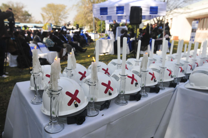 FILE PICTURE: Hardhats and candles on display, 15 August 2014, at the Lonmin offices in Marikana, North West,  to commemorate those who lost their lives during the August 16 Marikana massacre. Picture: Alaister Russell