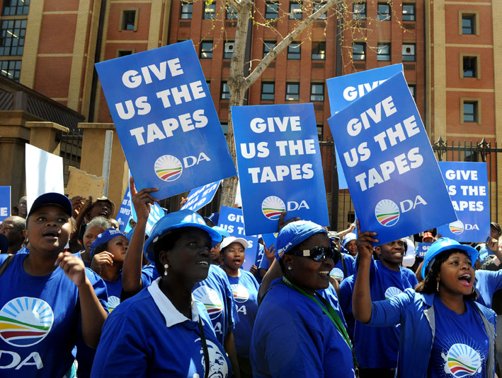 FILE PICTURE: Democratic Alliance supporters sing and dance outside the High Court in Pretoria. Picture: Werner Beukes/SAPA