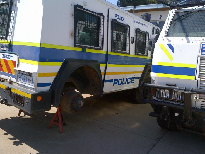 Johannesburg Public Order Policing vehicle stands on a jack while waiting for new tyres. Picture: Supplied