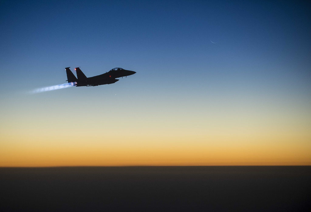 This US Air Forces Central Command photo released by the Defense Video & Imagery Distribution System (DVIDS)  shows a US Air Force F-15E Strike Eagle flying over northern Iraq early in the morning of September 23, 2014 after conducting airstrikes in Syria.  These aircraft were part of a large coalition strike package that was the first to strike ISIL targets in Syria.  AFP PHOTO / US Air Force