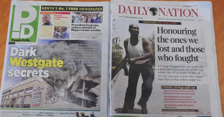 Kenyan newspapers with headlines on the Westgate mall terror attack are pictured on September 19, 2014
