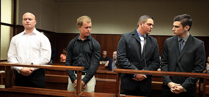 FILE PICTURE: Durban brothers Blayne and Kyle Shepard, Andries van der Merwe, and Dustin van Wyk appear at the Durban Regional Court on March 10, 2014 in Durban, South Africa. The four men stand trial for the for the murder of former Royal Marine Brett Williams. (Photo by Gallo Images / Sowetan / Thuli Dlamini)
