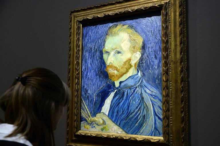 AFP/File / Bertrand Guay<br />A visitor looks at a self-portrait by Vincent Van Gogh displayed at the Orsay Museum in Paris