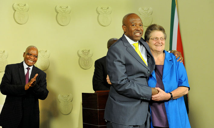 Lesetja Kganyago  is congratulated by outgoing SA Reserve Bank governer Gill Marcus (R) after it was announced by President Jacob Zuma (L) that he will become the new SA Reserve Bank governor in Pretoria on Monday, 6 October 2014.  He will take over from her on November 9. Picture: GCIS/SAPA