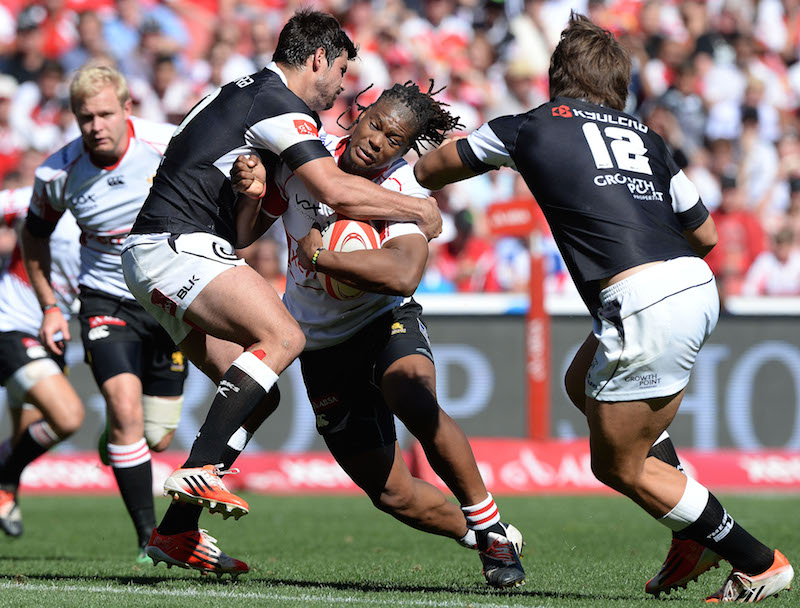 Howard Mnisi of the Lions gets tackled during the Absa Currie Cup semi final match between Xerox Golden Lions and Cell C Sharks at Ellis Park on October 18, 2014 in Johannesburg, South Africa. Picture: Duif du Toit/Gallo Images