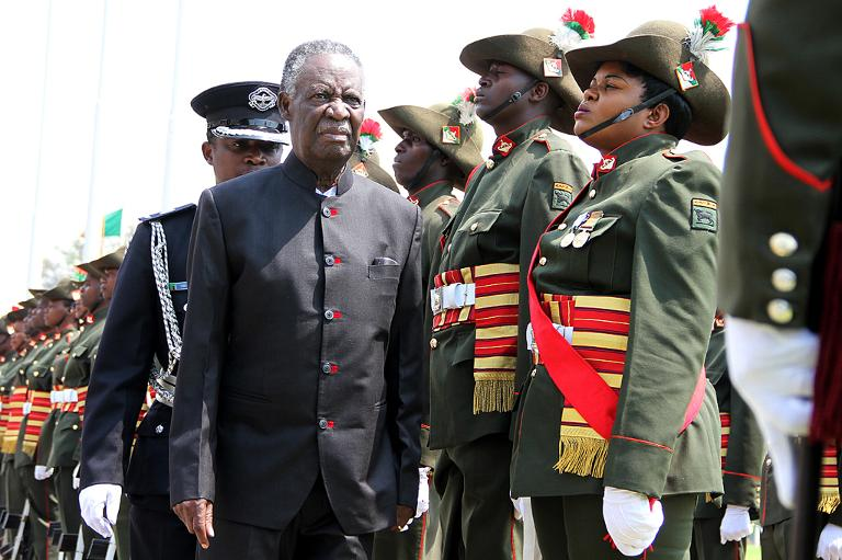 FILE PICTURE: Zambia's President Michael Sata (L) reviews a guard of honour outside the National Assembly building on September 19, 2014 in Lusaka. Picture: AFP