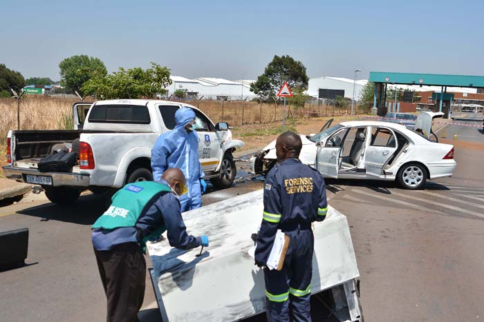 FILE PIC: Forensic experts collect evidence at a scene of a heist that took place in the early hours of the morning, 23 October 2014, where a cash-in-transit vehicle was ambushed while leaving the OR Tambo International Airport cargo area. The armed robbers got away with an undisclosed amount of money.  Picture: Valentina Nicol