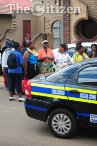 Memebers of the public start to gather at the house in Vosloorus, where Bafana Bafana Captain Senzo Meyiwa was shot dead last night, 27 October 2014.  Picture: Tracy Lee Stark