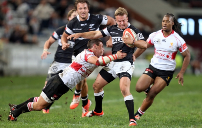 FILE PICTURE: Marnitz Boshoff of the Xerox Golden Lions tackling Fred Zeilinga of the Cell C Sharks during the Absa Currie Cup match between Cell C Sharks and Xerox Golden Lions at Growthpoint Kings Park on October 03, 2014 in Durban, South Africa. (Photo by Steve Haag/Gallo Images)