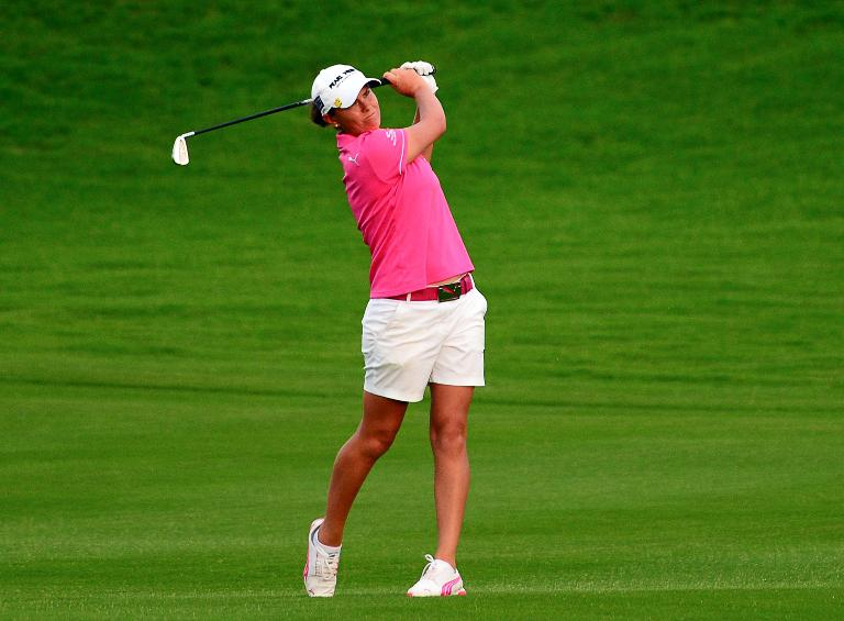 FILE PICTURE: Lee-Anne Pace hits a fairway shot during the final round of the LPGA Blue Bay Championship in Sanya on October 26, 2014
