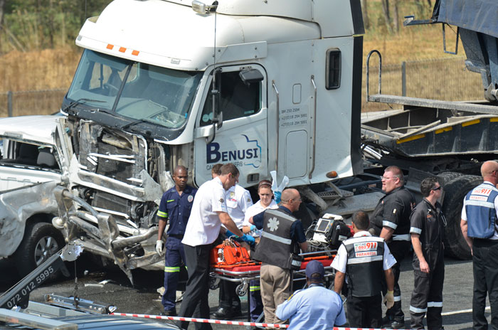 A general view of the accident scene is pictured, 14 October 2014, on the N12 near Alberton, South of Johannesburg, after a truck lost control due to mechanical failure and crashed into a static traffic jam. Over 40 cars were involved in the incident.  Picture: Alaister Russell