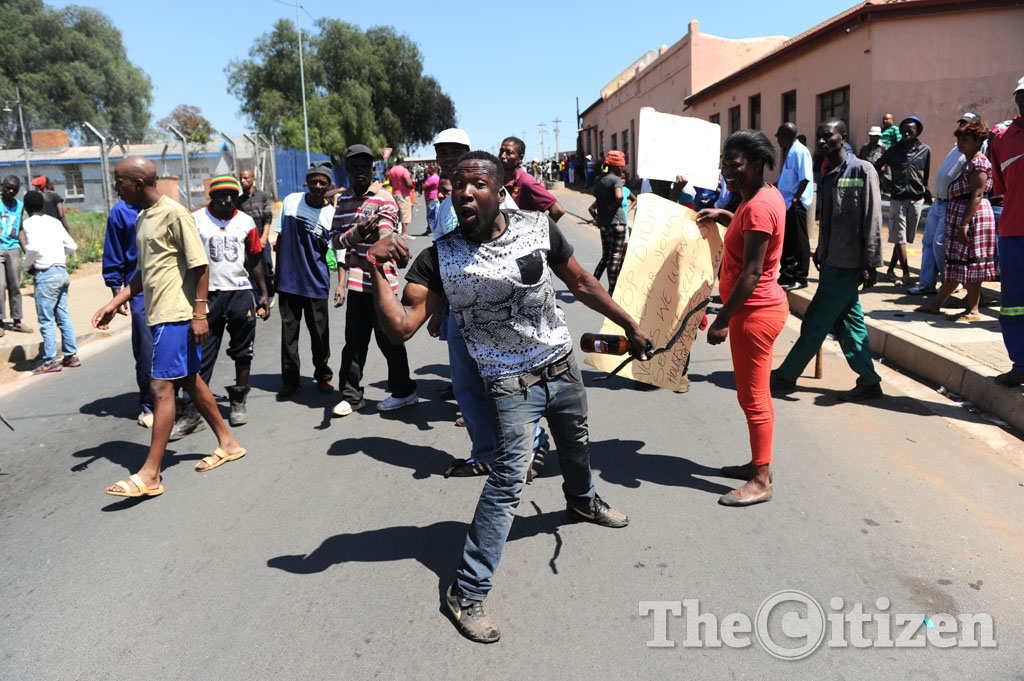 Newclare residents protest, 6 October 2014, for better services and housing. The protesters earlier set fire to the train station and nearby vehicles. One person was shot dead in the protests. Picture: Michel Bega