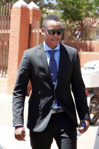 FILE PICTURE: President Jacob Zuma's son Duduzane Zuma leaves the Randburg Margistrate Court on November 5, 2014 in Johannesburg, South Africa. Zuma's was attending an inquest into a crash in which taxi passenger Phumzile Dube died after his Porsche hit the back of the taxi and the taxi overturned. (Photo by Gallo Images / Sowetan / Antonio Muchave)