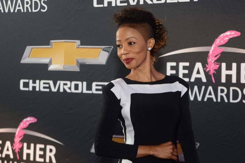 Singer Kelly Khumalo poses for pictures on the pink carpet at the Feather Awards in Johannesburg, 12 October 2014. Picture: Refilwe Modise