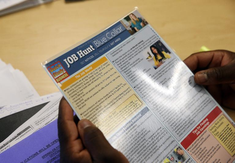 Getty/AFP / Justin Sullivan<br />Career counselor Alex Francois reviews a document with information about finding jobs at the Western Addition Neighborhood Access Point on April 17, 2014 in San Francisco
