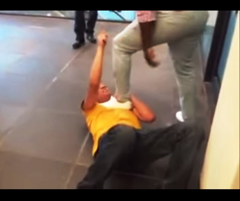 A screen grab of a  video uploaded on YouTube on Sunday has gone viral. The video shows a fight between two men in a shopping centre after one called the other the k-word. Photo: YouTube